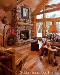 golden eagle log homes beautiful fireplace and wood floor in our modified