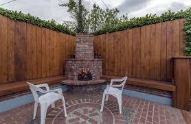 wood fence backyard. Wood Fence Surrounding Backyard Brick Patio With Fireplace R