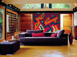 Indian Style Living Room Decorating Colourful Textiles And Wooden Walls In An Indian Style Living Room