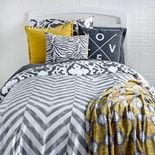 astounding urban gray chevron reversible ikat bedding with decorative pillows and white headboard