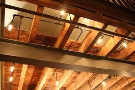 exposed lighting. exposed wood joists and steel beam httpcdnbrownstonercom lighting