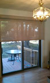 roman shade wide enough to cover fixed and sliding portion of door continuous loop