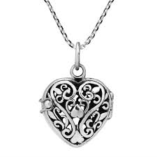 filigree swirls embos the heart design of this locket give your style a romantic twist with this necklace from thailand this necklace includes an