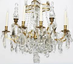 beautiful french crystal chandelier with canopy of arched gilt bronze arms hung with flower shaped crystal
