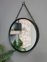 large round black mirror with hanging