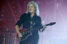 Queen's Brian May brands Sacha Baron Cohen an 'a***' over Freddie ...