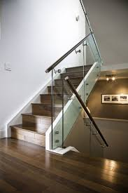 custom made maple stair with glass railing and stainless steel handrail and stand offs