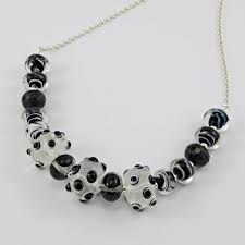 gorgeous clear lampwork glass beads are the feature of this necklace the large beads have