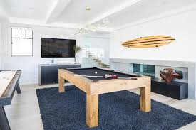chunky wood pool table on blue wool rug