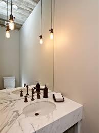 bare bulb lighting. plain bulb farmhouse powder room idea in san francisco with marble countertops for bare bulb lighting