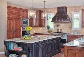 atlas tile tan marble counter tan horizonatal brick backsplash and wood floor