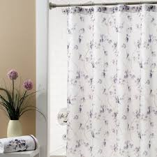 white fabric shower curtain with purple floral pattern and chrome