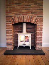 red brick fireplace flooring charming wood burning fireplace chimney design with white paint color schemes using