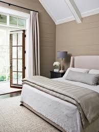 small neutral bedroom with french door