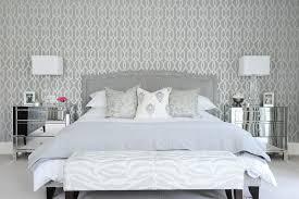 gray bedroom with mirrored nightstands