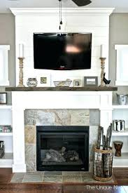 pictures of tv over fireplace over fireplace ideas amazing the best on above throughout pictures of