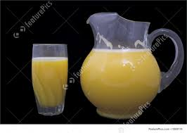 glass of orange juice orange juice in a drinking glass and a pitcher