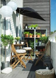 narrow balcony furniture. a narrow balcony with wooden table and chairs in the sun shelves rows furniture