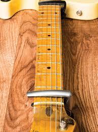 25 fender telecaster tips mods and upgrades guitar com all image of a telecaster neck being adjusted