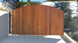 wood redwood electrical driveway gate outside by