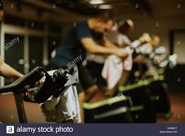 weightloss group cycling class group indoors weightloss fitness workout stock photo