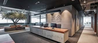 Image Innovative Design With Muted Colour Palette De Rahm Rearticulated It To Express An Elegant Industrial Design Language However The Hardedged Characteristics Commercial Interior Design Olive Tree Takes Centre Stage In Minimalist Industrial Office By