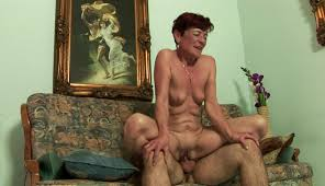 A nasty old woman receives a young cock in her meaty pussy.