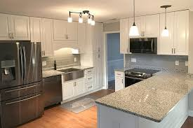 white kitchen cabinets with gray granite countertops