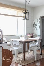 cottage pendant lighting. White Cottage Banquette Small Wooden Dining Table And 3 Chairs Beige Area Rug Single Pendant Lighting