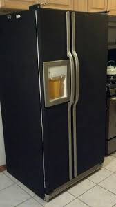 cover an ugly fridge with 4 rolls of contact paper home sweet home contact paper counter top and refrigerator makeover