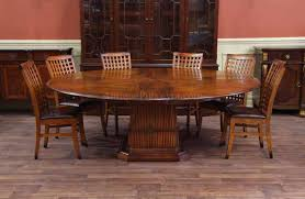 solid walnut round dining table with tropical pedestal and leaves