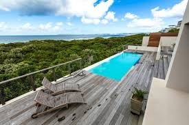 wood patio with pool. Sliding Deck Over Swimming Pool The Light Gray Wood Patio Is Also A Balcony With D