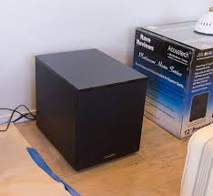 but this monstrous black box just didn t fly with my design plans for the space so i decided to make it functional by hiding it underneath a table