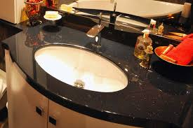 black vanity top with an undermounted sink in black sparkle granite