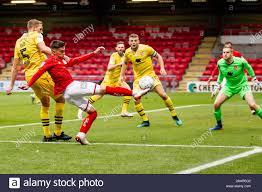 CREWE, ENGLAND - NOVEMBER 23RD Under pressure from Steven Old of Morecambe  fc Owen Dale of Crewe