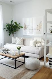 Fresh feeling living space decor. Light beige couch, with beige and white  pillows and