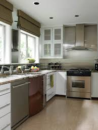kitchen backsplash white cabinets. Sleek Components And Surfaces Comprise A Thoroughly Contemporary Kitchen  Whose Range Wall Is Sheathed In Stainless Steel. White Painted Cabinets Backsplash White E
