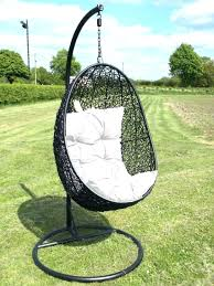 hanging swing chair outdoor egg outdoor chair oval black wicker hanging swing chair with white cushion