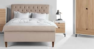 bed side furniture. a bedside table lamp in deep grey and american oak bed side furniture
