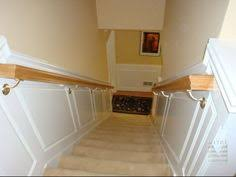 stairway wainscoting and oak handrails find this pin and more on stairway chair rail
