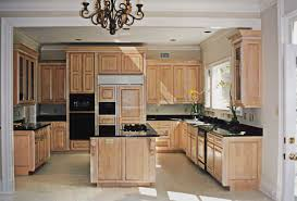 image of maple cabinets with black granite countertops