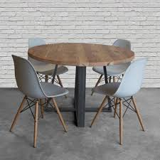 round wood dining tables farmhouse round wood table in reclaimed wood and steel legs in your