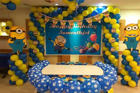 minion themed stage and cake table decorations and flex with baby s name
