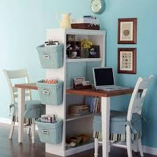 small space home office with dual desks blue walls and white accents blue office walls