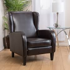 black leather wingback chair with ikea side table and table lamp plus interior potted plant on wood flooring