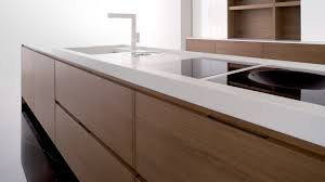 corian kitchen top: interesting white corian vs granite countertop with wood cabinets for modern home design ideas