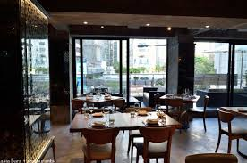 sal curioso the front of the restaurant features floor to ceiling sliding glass doors