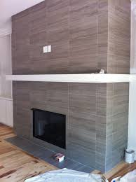 12x24 porcelain tile on fireplace wall and return walls floor to ceiling