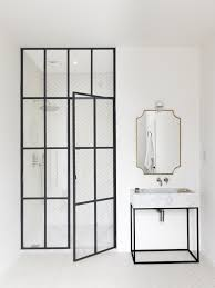luxury master bathroom by studio maclean west london with steel framed shower door chris