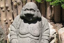 many stone figures reinforce the japanese atmosphere in this garden for example a magnificent pair of stone foo dogs sits in front of a small rock pool at